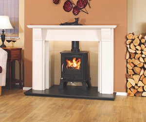 The Setubal Portuguese Limestone Fireplace is a versatile surround is shown with a honed black granite hearth and optional stone designed vermiclite chamber, aperfect combination that will bring life to any living space.