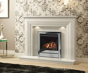 "Vitalia. Grand presence of this stunning 1320mm (52"") micro marble surround, with its fine detailing and stepped design, the Vitalia is an uncompromising and stylish feature for any interior. Shown in white finish with Chollerton widescreen gas fire with chrome trim."